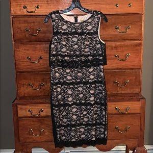 Black lace Nicole Miller knee length dress.